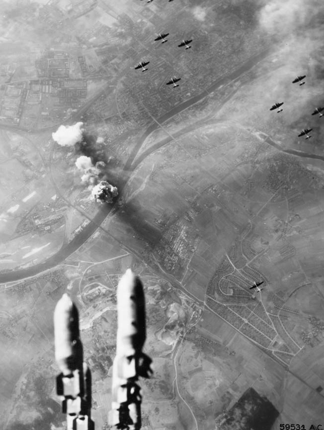 B-17 Flying Fortress bombers of the U.S. Eighth Air Force maintain formation above the German city of Regensburg during a daylight bombing raid. The Americans maintained that greater accuracy was achieved during daylight raids, but German flak and fighters took a fearful toll on the bombers.