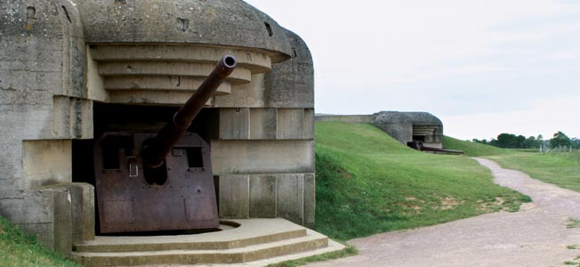 A view of two of the four casemates of the Longues-sur-Mer battery, located between Omaha and Gold Beaches. I