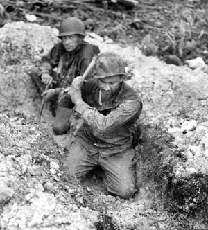 Members of the 1st Cav's 5th Cavalry Regiment dig positions immediately after landing on February 29. Japanese resistance proved tougher than expected.