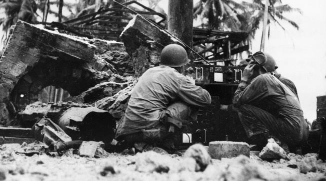 Using an SGR-193, 5th Cavalry radiomen call for supporting naval fire within 15 minutes of the first wave's landing.