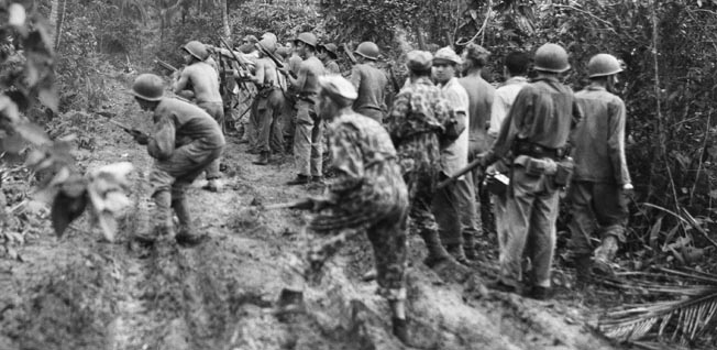While on patrol through the thick jungle, an American unit reacts to contact with the enemy.
