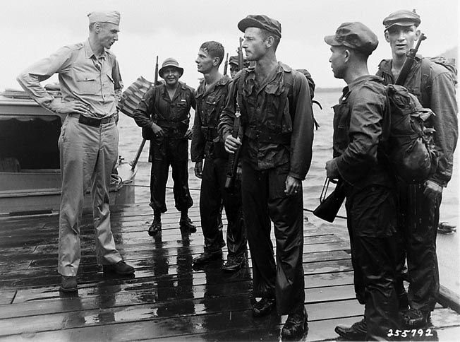 Members of the Alamo Scouts, a reconnaissance team, arrived at the southeast point of Los Negros two days before the invasion to report on Japanese defenses.