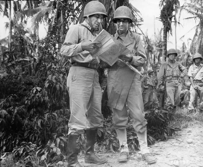 X Corps commander Lt. Gen. Franklin Sibert (left) confers with Maj. Gen. Frederick Irving, 24th Infantry Division commander, on Leyte, October 1944.