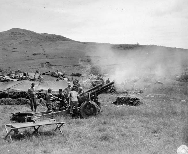 A 105mm artillery battery opens fire on Japanese positions.