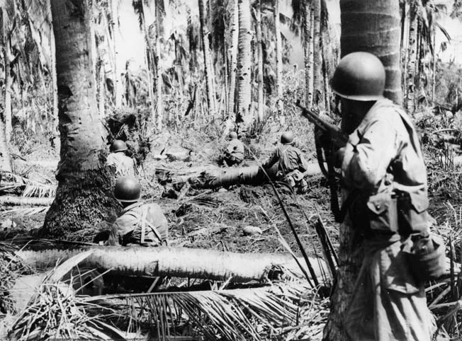 Soldiers cautiously advance toward a Japanese machine-gun nest on Leyte.