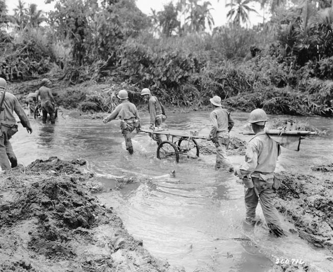 Medics from the 19th Infantry Regiment cross a stream to pick up wounded. During its six months of combat on Leyte, the 24th Infantry Division suffered 2,342 casualties, including 544 dead.