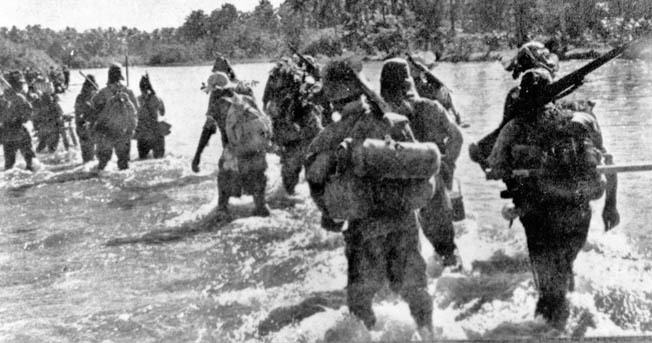 Japanese troops ford a river in the Philippines in this captured war photograph. The Japanese lost 70,000 men killed, wounded, or missing on Leyte.