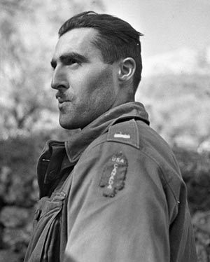 Canadian Lieutenant J. Kostelec wears the red spearhead patch on his field jacket.