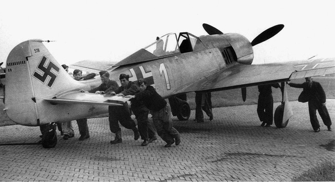 Luftwaffe ground crewmen push into position a Focke-Wulf Fw-190 of the type flown by the author.