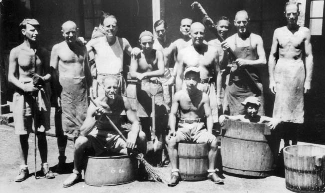 A group of kitchen workers at Lungwha strike a carefree pose. Joan's father, John, is standing at far left.