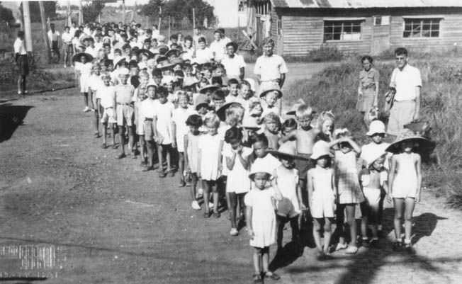 Interned foreign children on their way to school in the Lungwha camp in Shanghai, China. Joan Borsberry attended the school.
