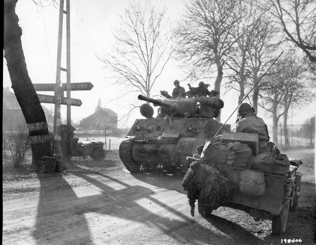 ABOVE: A 9th Armored Division M4 Sherman tank moves up in attempt to stem the German breakthrough, December 27, 1944.