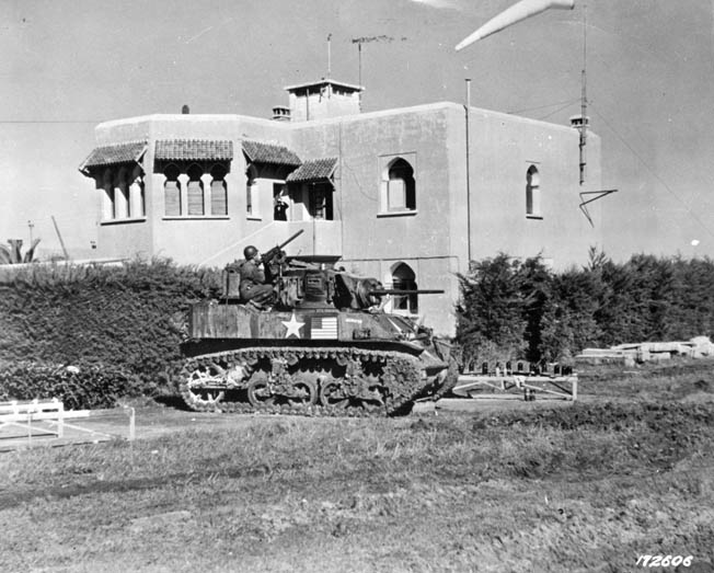 This Stuart light tank is equipped with a 37mm main weapon and a .30-caliber machine gun in the turret glacis for defense against enemy infantry. This photograph was taken in the city of Casablanca a few days after the Operation Torch landings.