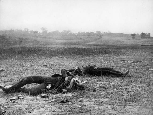 Two Confederates lie dead near Burnside's Bridge. They put up a stout defense for much of the day but were eventually overwhelmed.
