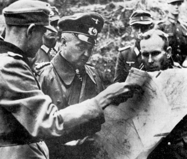 Field Marshal Walther Model, commander of German Army Group G, confers with Colonel Gerhard Wilck, who led the 246th Volksgrenadier Division during the tough fighting around the city of Aachen.