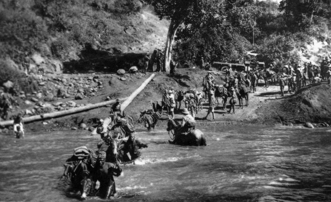 Part of the South African Brigade crosses the Kiakafu River en route to Arusha in April 1916. Primitive conditions took a toll on men and horses.