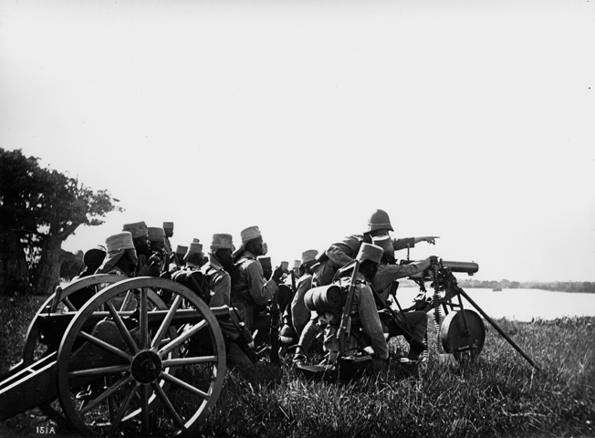 German-led Askaris (native troops) man a machine gun position in East Africa at the beginning of World War I.