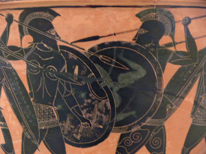 Trained from boyhood for battle, Greek hoplites face off at spear point.