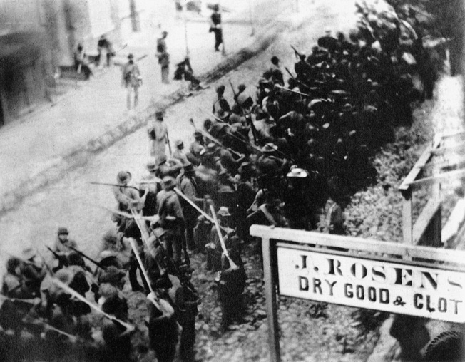 A ragged column of Confederate troops passes through Frederick, Maryland, in an extremely rare photograph depicting Southern troops in action.