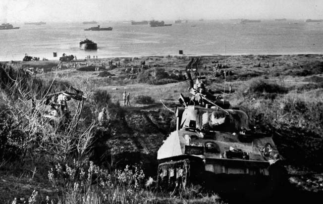 An American tank rolls forward to the crest of a hill just off the beach at Anzio. When the Germans realized that Rome was threatened, they reacted swiftly and hemmed in the VI Corps on the beach.