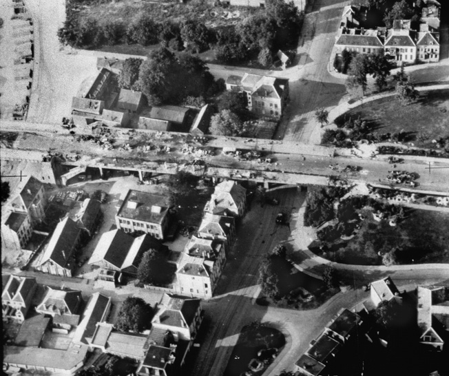 The pilot of a Royal Air Force reconnaissance aircraft snapped this photo of the north end of the Arnhem bridge and the destroyed German armored cars and troop carriers that were hit by British paras on the afternoon of the second day of fighting during Operation Market-Garden.
