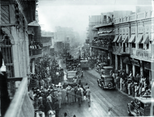 Baghdad at the time of the German-leaning coup. Soldiers are seen riding through the streets in open trucks.