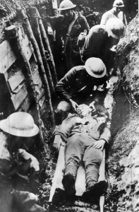A Badly wounded Marine receives first aid before being sent to a hospital in the rear.