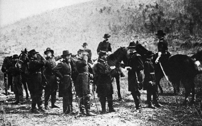 """Fighting Joe"" Hooker confers with his staff at the foot of Lookout Mountain. Hooker's unexpected victory there redeemed his earlier failure at Chancellorsville."