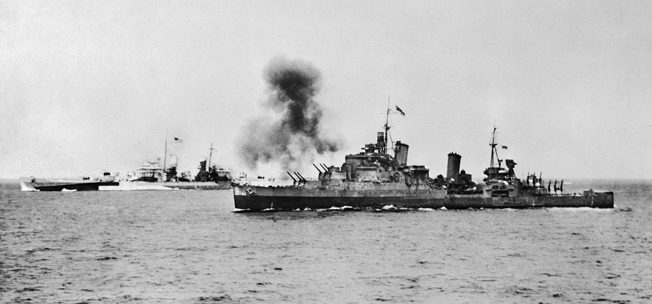 HMS Glasgow, right, and USS Clancy fire on Cherbourg to support advancing ground forces on June 25, 1944.