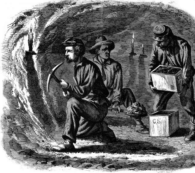 Former coal miners from the 48th Pennsylvania dig out a tunnel below Confederate lines with picks and shovels, carrying out the dirt in hardtack crates. They completed the backbreaking work in three weeks.