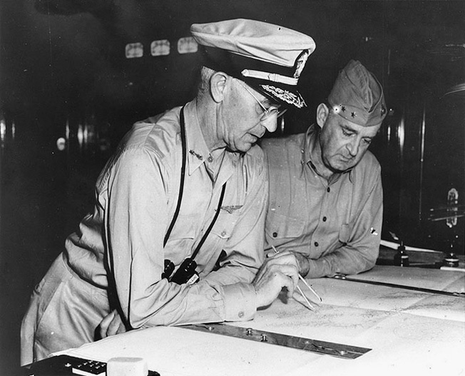 Maj. Gen. Alexander A. Vandergrift (left), commander of the 1st Marine Division, and Admiral Richmond Kelly Turner, chief of the U.S. Navy War Plans Division, discusses the upcoming invasion of Guadalcanal aboard the USS McCawley.