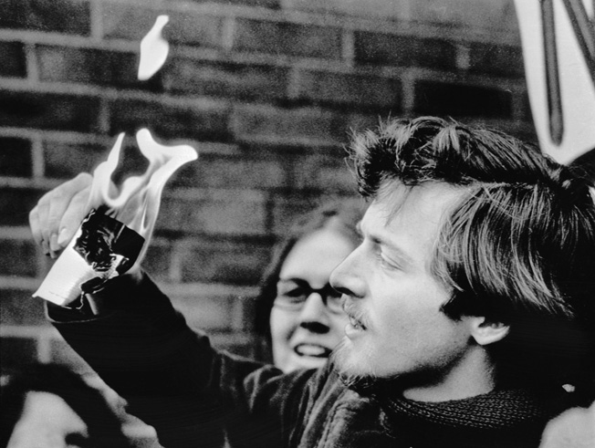 University of Wisconsin Student Goddard C. Graves burns his draft card at the height of the Vietnam War protests.