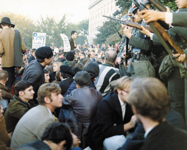 Armed MPs hold back Vietnam War protesters during their sit-in at the mall entrance to the Pentagon on October 21, 1967.