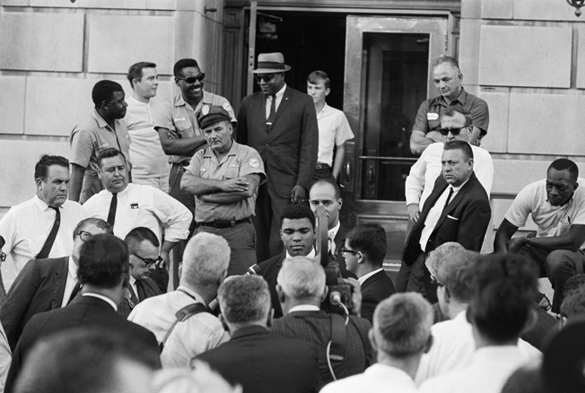 Heavyweight boxing champion Muhammmad Ali holds an impromptu press conference in his hometown of Louisville, Kentucky, after refusing to take an induction oath.