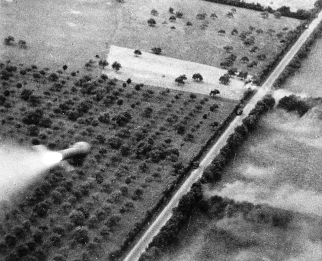 In a still frame from gun-camera footage, a rocket fired from a British Hawker Typhoon streaks toward a German convoy trying to escape the Falaise-Argentan gap near Livarot. In a still frame from gun-camera footage, a rocket fired from a British Hawker Typhoon streaks toward a German convoy trying to escape the Falaise-Argentan gap near Livarot.