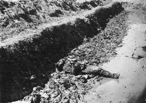 A dead confederate soldier lies amid the muck of Petersburg's trenches.