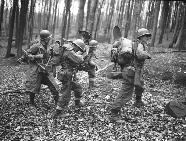 Men of the 100th Infantry Division penetrate the long-dormant Maginot Line at Bitche, in eastern France, en route to Germany.