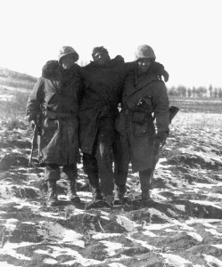 Late on November 27, two Marines help a wounded buddy back to an aid station.