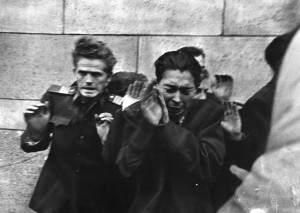 AVH secret policemen, hands raised to protect themselves, are gunned down by Hungarian rebels.