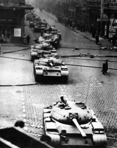 A long, ominous line of Soviet tanks rumbles through an intersection in downtown Budapest during the height of the rebellion.