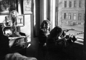 Two female Hungarian patriots take aim with their submachine guns in the window of a house.