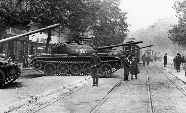 More Russian tanks stand ready for action in Budapest on October 30, 1956. Citizens look on warily.