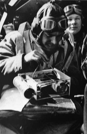 Helmut Rau, left, in the observer seat, taking weather readings in an He-111 in the summer of 1941.