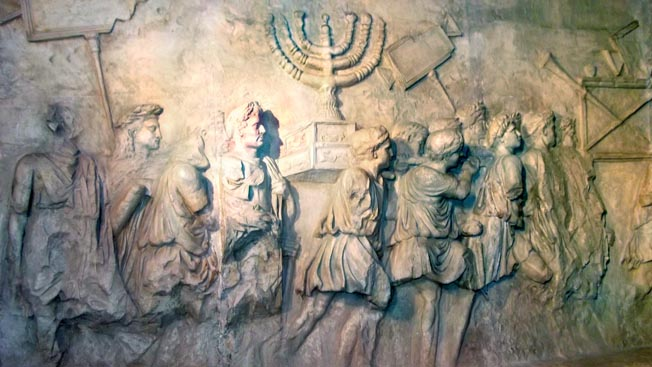 A relief on the Arch of Titus in Rome shows victorious soldiers carrying the vanquished Jews' seven-branched Menorah and trumpets high above their heads.