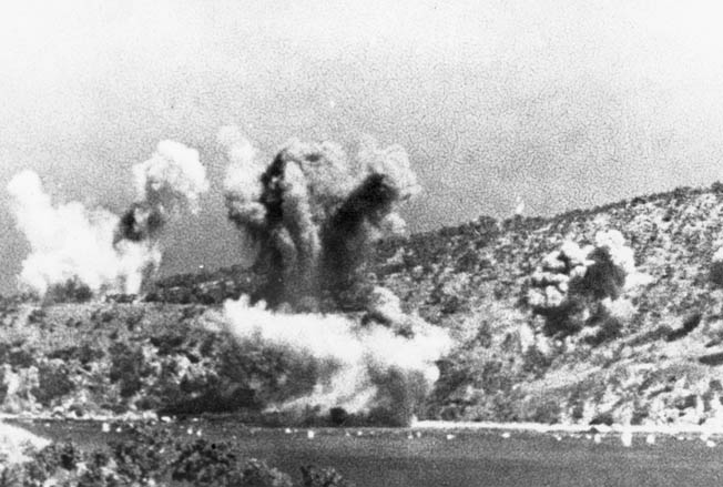 Japanese munitions burst on the hills surrounding the Allied air bases at Milne Bay. The IJN's failure to take the bases led to Japan's first major defeat of the war and showed the Allies the enemy was not invincible.