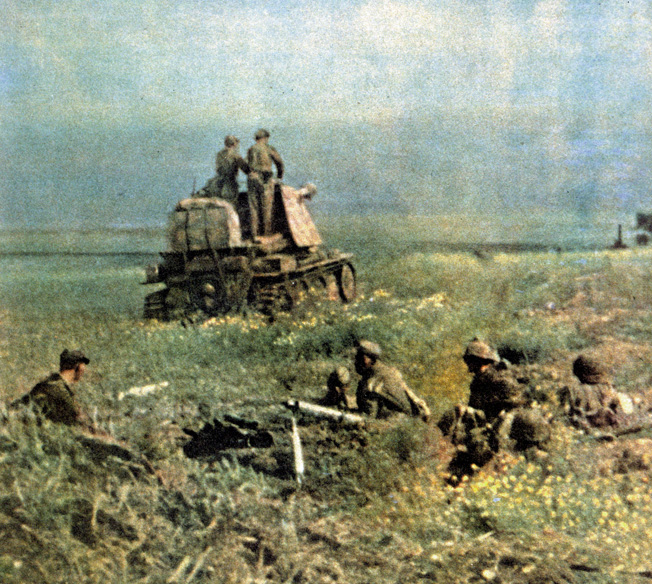In an attempt to beat back a Red Army breakthrough near Beigorod, German artillery fires at the Soviet spearhead. In the foreground, a Waffen SS grenadier keeps watch over Soviet prisoners.