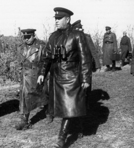Soviet Marshal Georgi Zhukov, a commander of the Red Army units engaged at the Battle of Kursk, strides to a meeting with subordinates. To his right is Aleksander Vasilevsky, chief of the Soviet general staff.