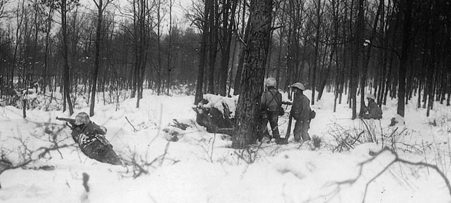 The extreme conditions of the Ardennes winter tested the mettle of infantrymen on both sides. Men of the U.S. 106th Infantry Division fight from foxholes.