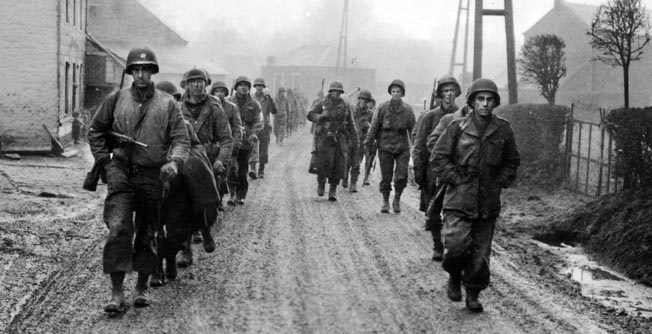 After delaying the Fifth Panzer Army's attack along the Our River, men of the 28th Infantry Division withdrew to Bastogne.