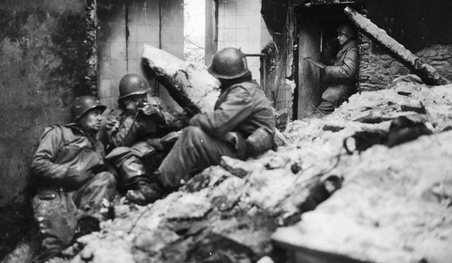 Americans at the 28th Infantry command post in Wiltz. The Germans shelled the key town in an effort to force the Americans to give up.